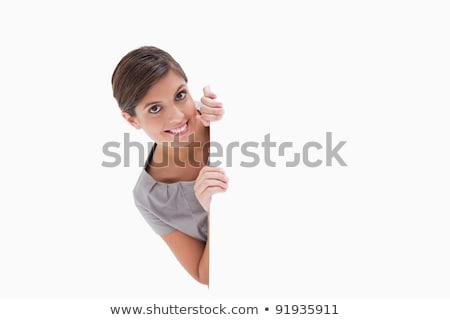 Kobieta patrząc około rogu biały tle Zdjęcia stock © wavebreak_media