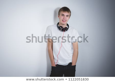 Rapper dől fal fiatal férfi graffiti Stock fotó © Spectral