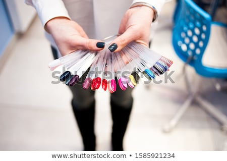 beautiful woman choosing nail polish Stock photo © chesterf