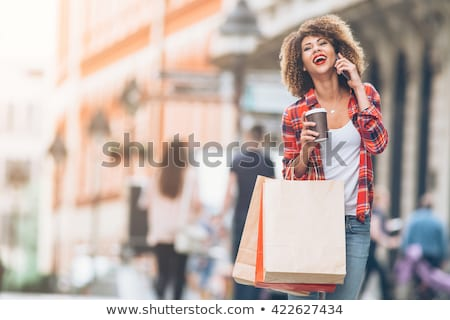 feliz · mulher · pensando · sorridente - foto stock © lithian