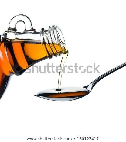 Arce jarabe cuchara blanco botella Foto stock © jirkaejc