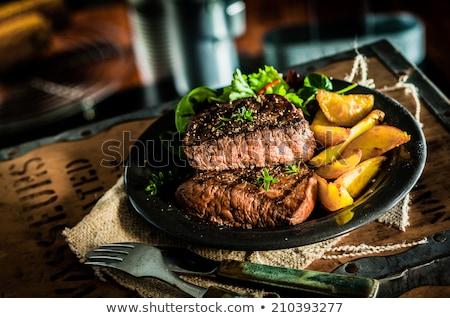 Klasszikus hús adag villa fehér háttér Stock fotó © RedDaxLuma