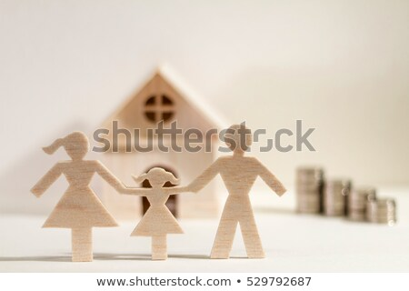 Paper family and stacks of coins  Stock photo © Grazvydas