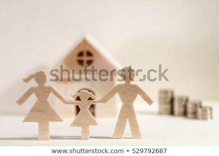 Papír család érmék pénz fogalmak fehér Stock fotó © Grazvydas