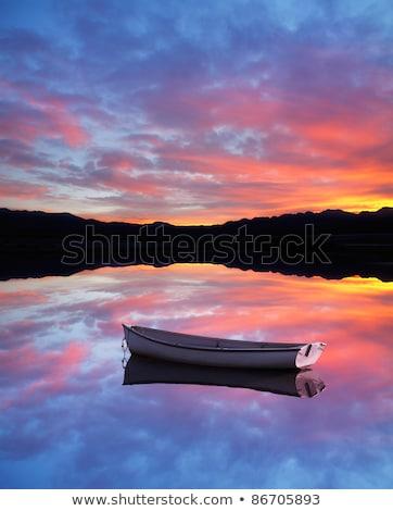 Kürek çekme tekneler tan gün batımı doğa Stok fotoğraf © olandsfokus