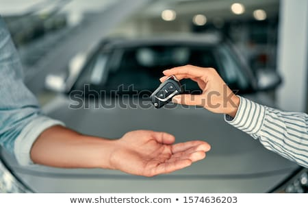 young cheerful woman sitting in a car with keys in hand stock photo © vlad_star