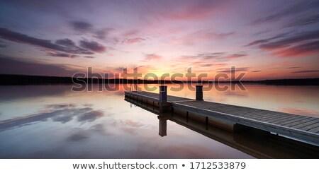 Pier coucher du soleil herbe Photo stock © ndjohnston