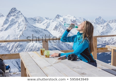 happy female snowboarder in winter mountains health lifestyle stock photo © nobilior