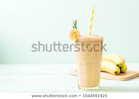 Healthy Banana smoothie on wooden background Stock photo © Lana_M