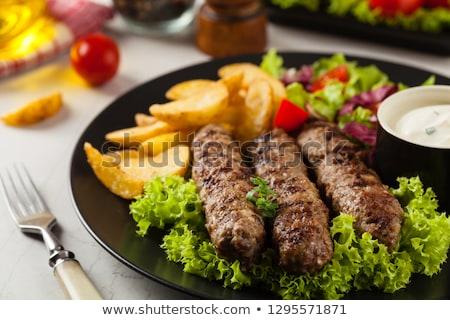 Stock photo: Cevapcici and potatoes