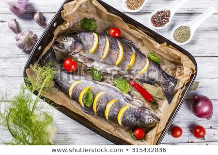 Sült pisztráng paradicsomok hagyma hal tányér Stock fotó © Digifoodstock