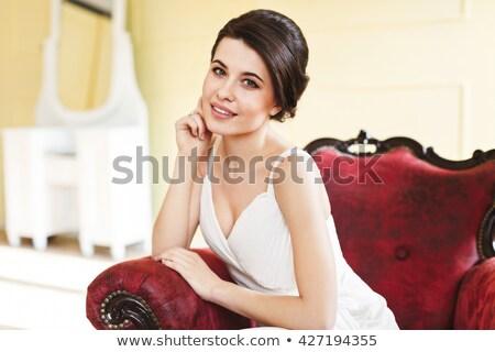smiling model kneeling on an armchair stock photo © giulio_fornasar