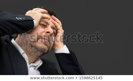 Tired man showing depression in dark background Stock photo © tab62