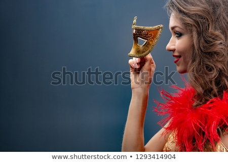 Gorgeous smiling woman in masquerade mask Stock photo © artfotodima
