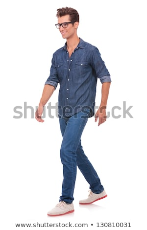 confident happy young casual man walking forward Stock photo © feedough