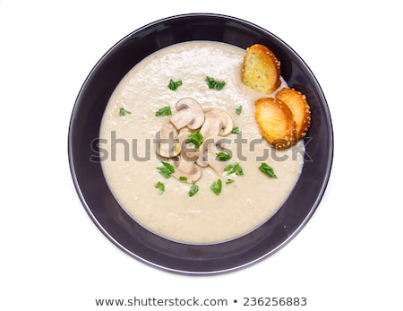 vegetable soup in white bowl on wooden rustic table. top view Stock photo © Yatsenko