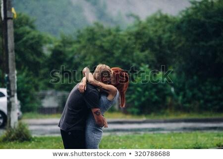 красивой · пару · дождь · за · пределами · женщину - Сток-фото © tekso