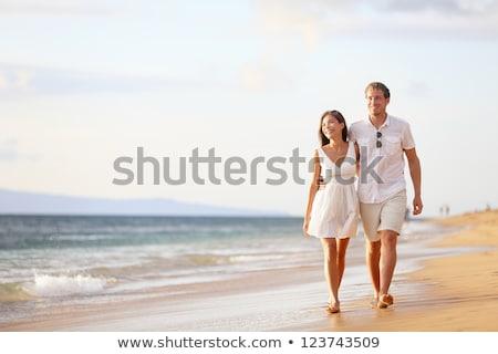 mulher · homem · abrir · mãos · coberto · areia · da · praia - foto stock © wavebreak_media