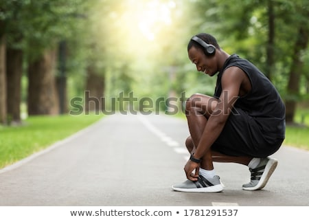 Side view of a male runner ready for sports exercise Stock photo © deandrobot