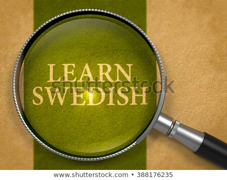 Learn Swedish through Loupe on Old Paper. Stock photo © tashatuvango