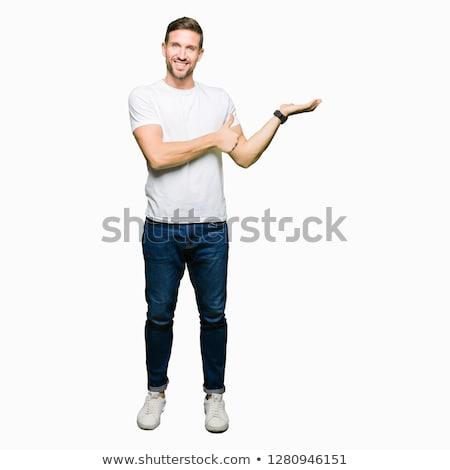 Caucasian business man showing palm hand. Stock photo © RAStudio