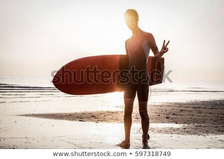 Sziluett szörfös készít béke szimbólum napfelkelte Stock fotó © DisobeyArt