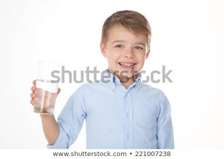 Weinig kaukasisch jongen glas water Stockfoto © RAStudio