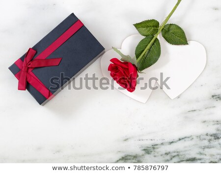 Overhead view of a single red rose on dark stone  Stock photo © tab62