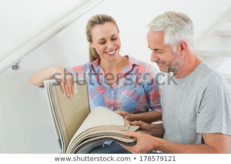 couple looking at carpet samples stock photo © is2