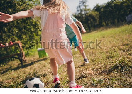 boy celebrating playing table football stock photo © is2