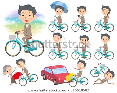 Beige suit short hair beard man ride on city bicycle Stock photo © toyotoyo