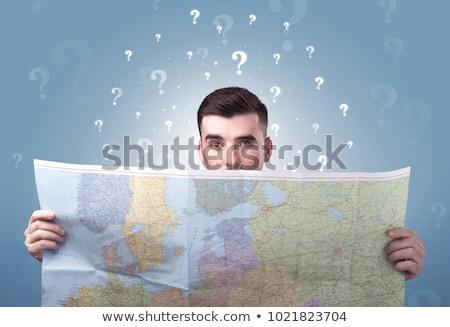 Jonge man kaart knap wereldkaart pijlen Stockfoto © ra2studio