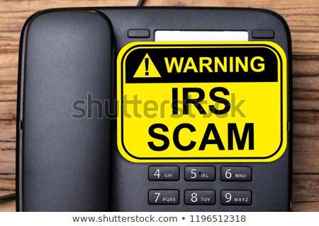 irs scam warning sign on landline phone stock photo © andreypopov
