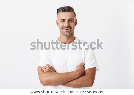 Portrait of european brunette man 30s with stubble in white shir Stock photo © deandrobot