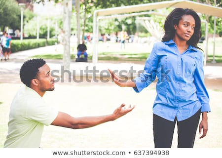 Portrait of a worried young afro american man begging Stock photo © deandrobot