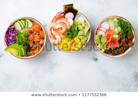 Stockfoto: Poke Bowl With Salmon Shrimps And Vegetables