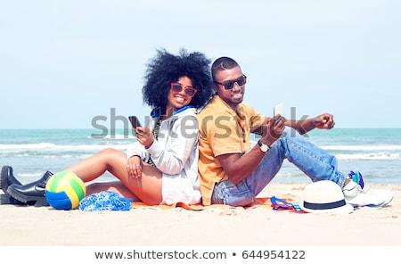 Sorridente moço óculos de sol bola de praia lazer verão Foto stock © dolgachov