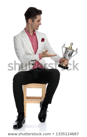 seated young elegant man presenting his award to a side Stock photo © feedough