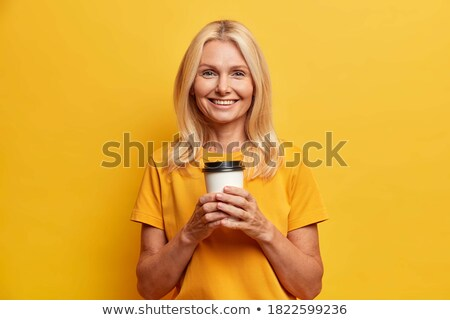 Attractive sincere blond woman enjoying coffee Stock photo © Giulio_Fornasar