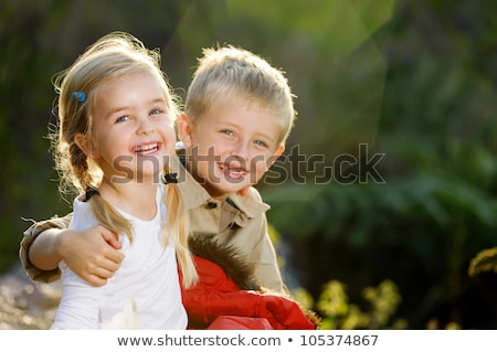 a portrait of adorable brother and sister together outdoors happy lifestyle kids stock photo © lopolo