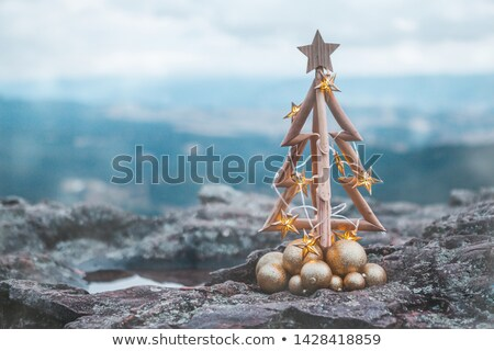 Christmas tree with gold lights and mountain backdrop Stock photo © lovleah
