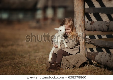 Kislány bárány farm húsvét tavasz boldog Stock fotó © galitskaya