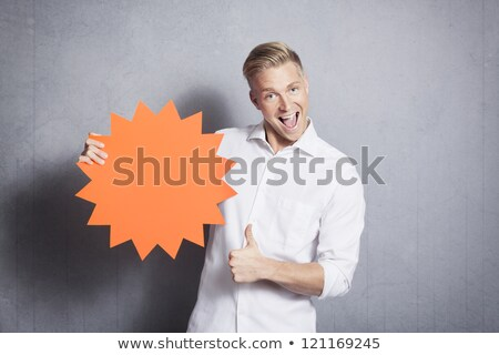 Salesman with thumbs up and empty sign promoting sales. Stock photo © lichtmeister