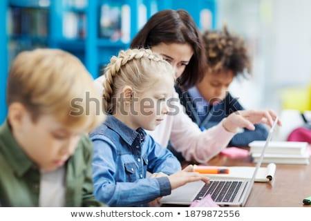 вид сбоку школьница изучения ноутбука столе классе Сток-фото © wavebreak_media