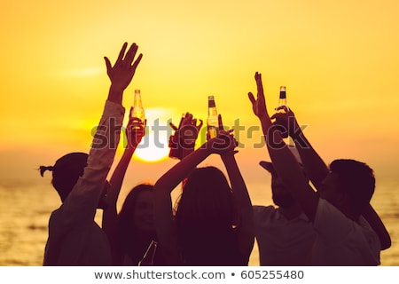 Group of friends toasting with beer Stock photo © Kzenon