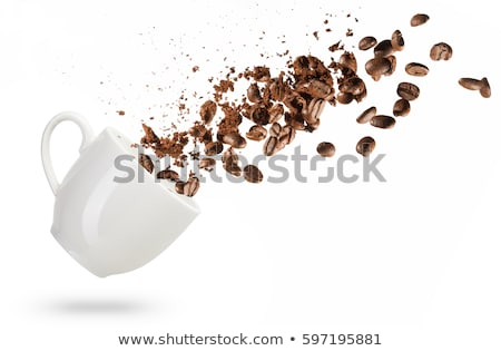 A White Cup of Hot Coffee in a Scattering of Coffee Beans on a Wooden Background Stock photo © Illia