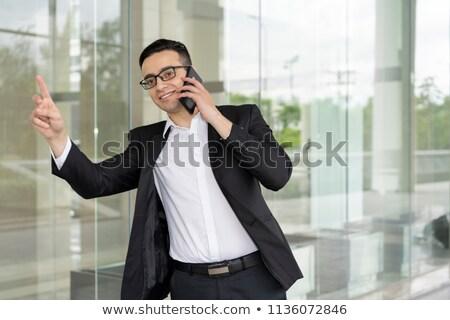 Facet taksówką młody człowiek przypadkowy ubrania Zdjęcia stock © jossdiim