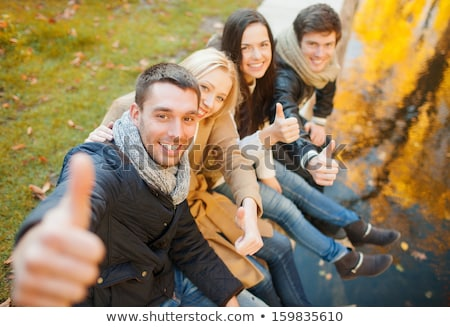 A beautiful autumn woman having good time. Stock photo © Lopolo