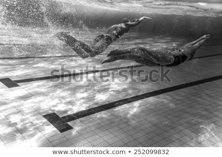 Scene with two swimmers in the pool Stock photo © bluering