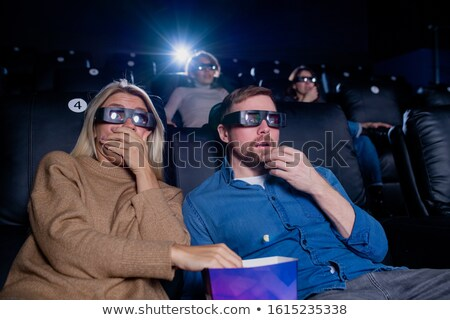 Young scared man and woman 3d eyeglasses watching horror or action movie Stock photo © pressmaster